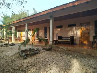 4 apartments  3 empty lots for expansion located in a very quiet area near Tamarindo  / by Owner